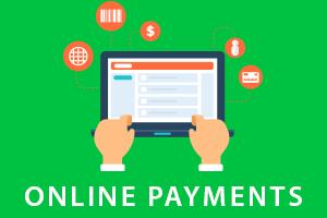 Hands below laptop making online payments