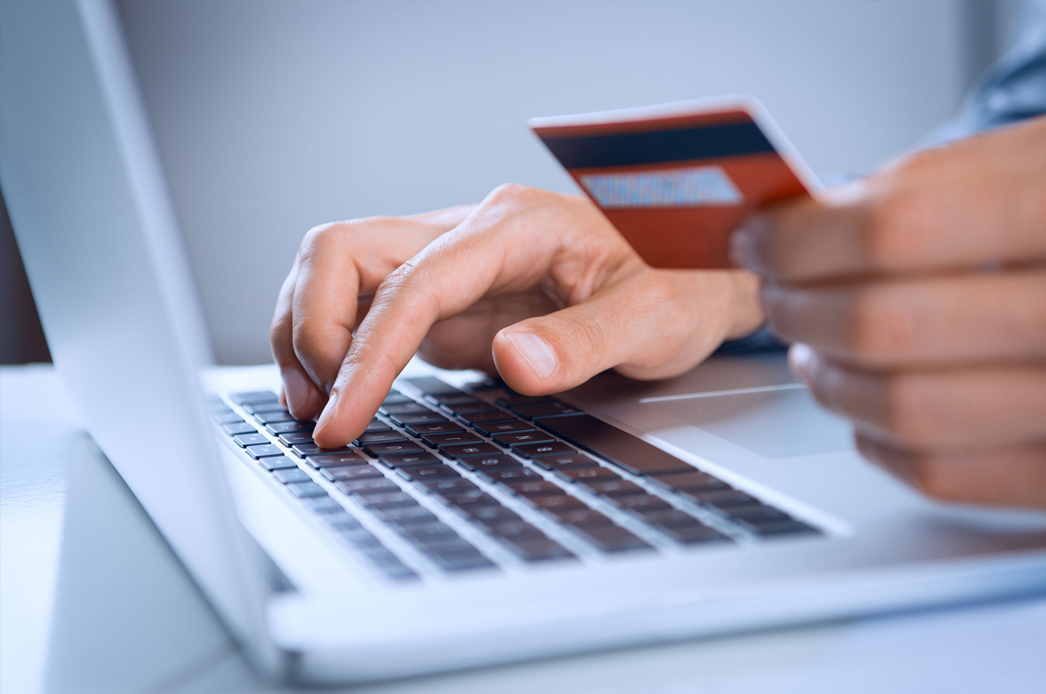 Making online payments on computer.